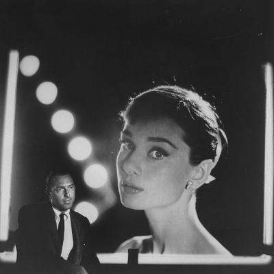 Photographer Allan Grant Sitting in Front of His Photograph of Actress Audrey Hepburn