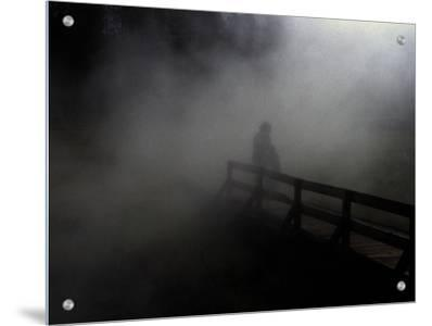 Adult and Children on Foggy Pier