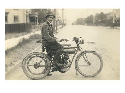 Black and White Photo of Man on Vintage Motorcycle