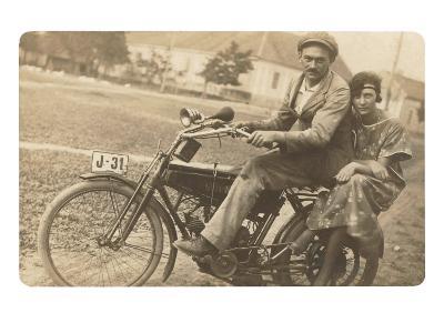 Couple on Motorbike