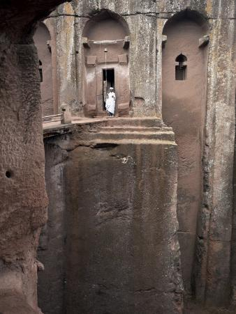 Priest Stands at the Entrance to the Rock-Hewn Church of Bet Gabriel-Rufael, Lalibela, Ethiopia