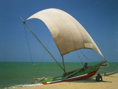 Fishermen in the Shade of a Sail on a Fishing Boat on the Beach at Negombo, Sri Lanka