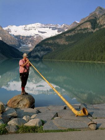 Man with an Alpenhorn Beside Lake Louise in the Banff National Park, Alberta, Canada, North America