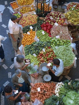 People at a Fruit and Vegetable Stall in the Market Hall in Funchal, Madeira, Portugal