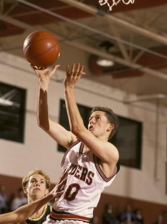 High School Boys Basketball Player Shooting