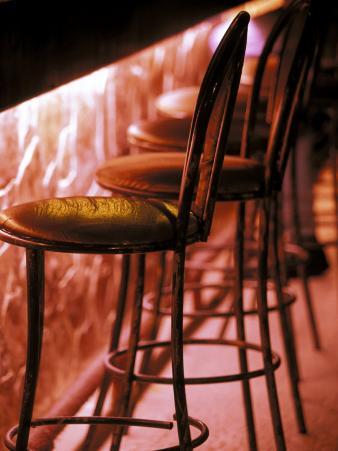 Barstools in pink light, Playa del Carmen, Quintana Roo, Mexico