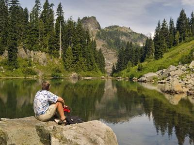 Hiker at the shore of the Tatoosh Lake, Tatoosh Wilderness, Washington State, USA