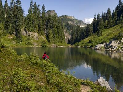 Lone hiker at Tatoosh Lake, Tatoosh Wilderness, Washington Cascades, USA