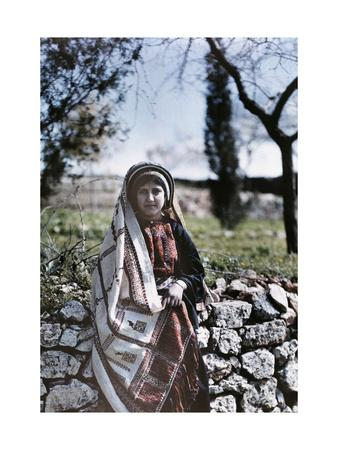Christian Schoolgirl of Ramallah Leans Against a Stone Wall