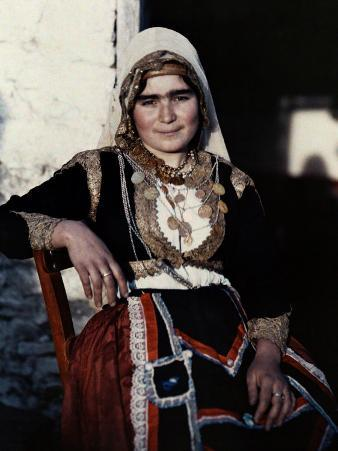 Woman Poses in the National Costume of Crete
