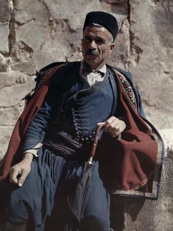 Man Poses in the National Costume of Crete