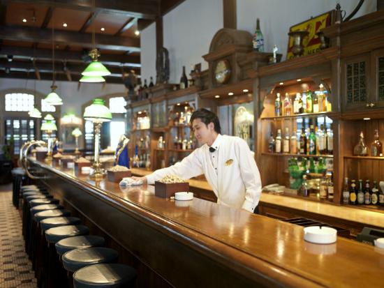 Bartender Wipes The Bar Counter In Raffles Hotel