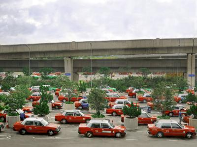 Taxis Parked in a Parking Lot Outside of the Hong Kong Airport Waiting for Passengers