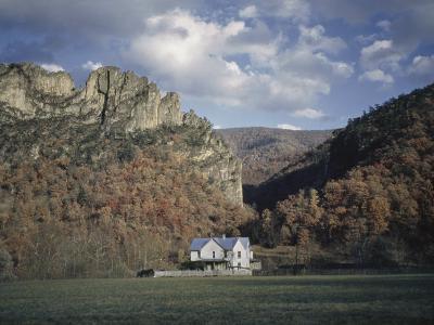 Seneca Rock's Quartzite Formations are the Backdrop for a Farmhouse