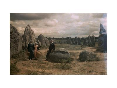 Bretton Women Sit Amongst the Megaliths of Carnac