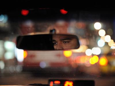 Close Up of a Taxi Driver's Eyes in Rearview Mirror of His Cab