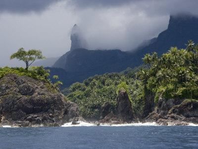 Volcanic Mountains and Palm Trees Along the Shore of Principe Island