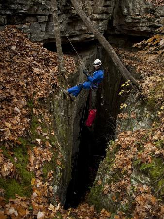 Caver Enters Thunder Hole Cave in the Little Coon Valley of Alabama