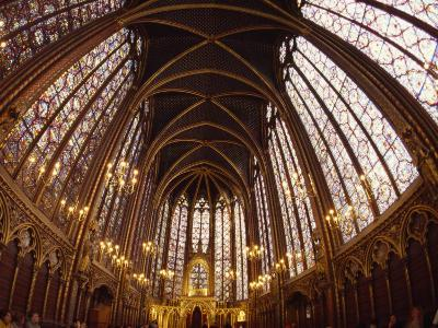 Tourists Viewing a Cathedral's Ceiling in Paris, France