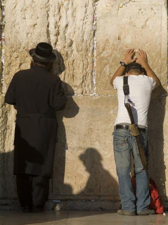 Orthodox Jew and Soldier Pray, Western Wall,Jewish Qt. Old City