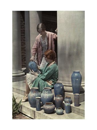 Two Newcomb Art Students Examine Some Ceramic Pots