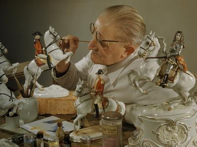 Craftsman Retouches Paint on Porcelain Figurines before Refiring