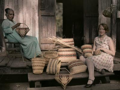 Ancestor of the Choctaws Sits Weaving Baskets with a Child