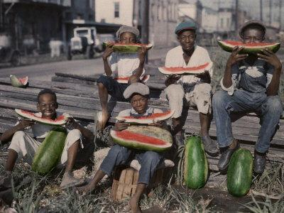Five Boys Sit Together, Eating Large Watermelon Slices