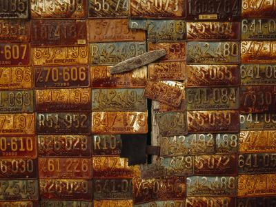 Side of a Building Adorned with Old License Plates