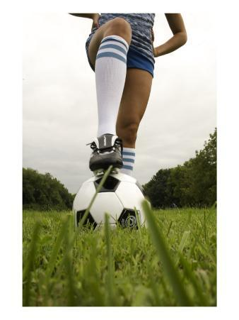 Player Standing on Soccer Ball