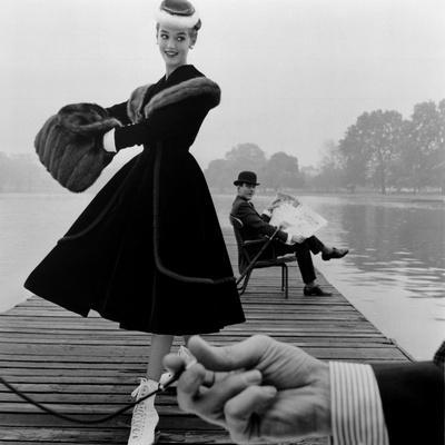 Skater in a Digby Morton Fur Trimmed Velvet Coat and Michael Bentley in the Background, 1955