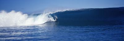 Surfer in the Sea, Tahiti, French Polynesia