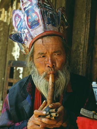 Naxi Dongba, or Wise Man or Shaman, Traditionally Acted as a Mediator with Spirit World