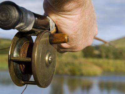 Wales, Conwy, Trout Fishing at a Hill Lake in North Wales, UK