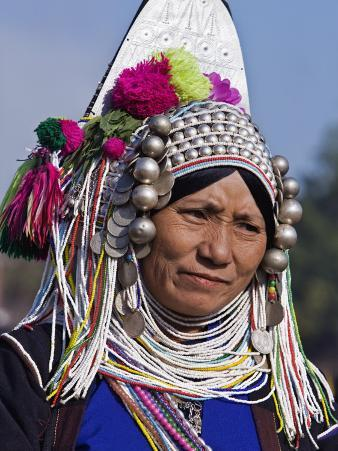 Burma, Kengtung, A Mong La Akha Woman Wearing a Traditional Headdress of Silver and Beads, Myanmar