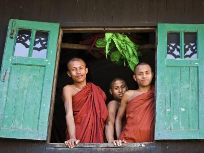 Burma, Rakhine State, Sittwe, Three Novice Monks Look Out of their Dormitory Window at the Pathain