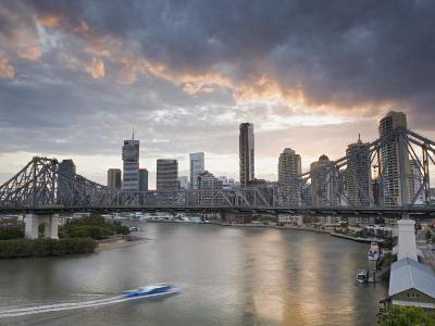 A Citycat Ferry Cruises Beneath Brisbane's Story Bridge Towards City Centre, Brisbane, Australia