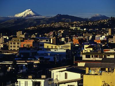 Sunrise on the City and Cotapaxi Volcano, Quito, Ecuador