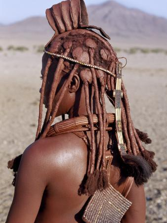 Himba Woman in Traditional Attire, Her Body Gleams from a Red Ochre Mixture of Red Ochre, Namibia