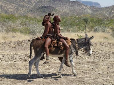 Two Happy Himba Girls Ride a Donkey to Market, Namibia