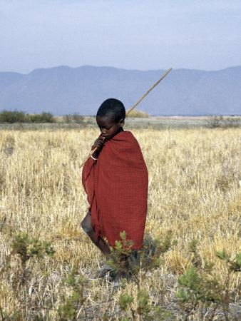 Young Boy of the Datoga Tribe Crosses the Plains East of Lake Manyara in Northern Tanzania