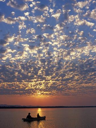 Canoeing under a Mackerel Sky at Dawn on the Zambezi River, Zambia