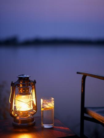 Gin and Tonic by the Light of Hurricane Lamp, Looking Out over the Zambezi River, Zambia