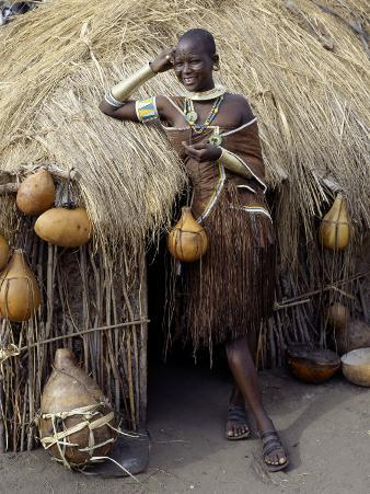 Datoga Woman Relaxes Outside Her Thatched House, Tanzania