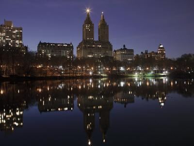 The San Remo Towers Skyline at Night Reflected in the Lake, Central Park, New York City