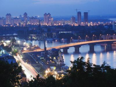 Lights Illuminating Podil District and Dnieper River Area at Night, Kiev, Ukraine, Europe