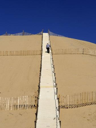 Man Climbing Steps Leading Up to Dunes Du Pyla, Bay of Arcachon, Cote D'Argent, Aquitaine