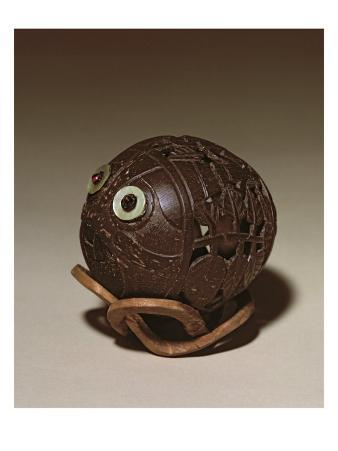 Coconut Sculpted into a Face, c.1895