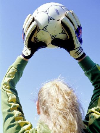 View from Behind of a Girl Holding a Soccer Ball