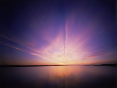 View of the Ocean Beneath Purple Skies